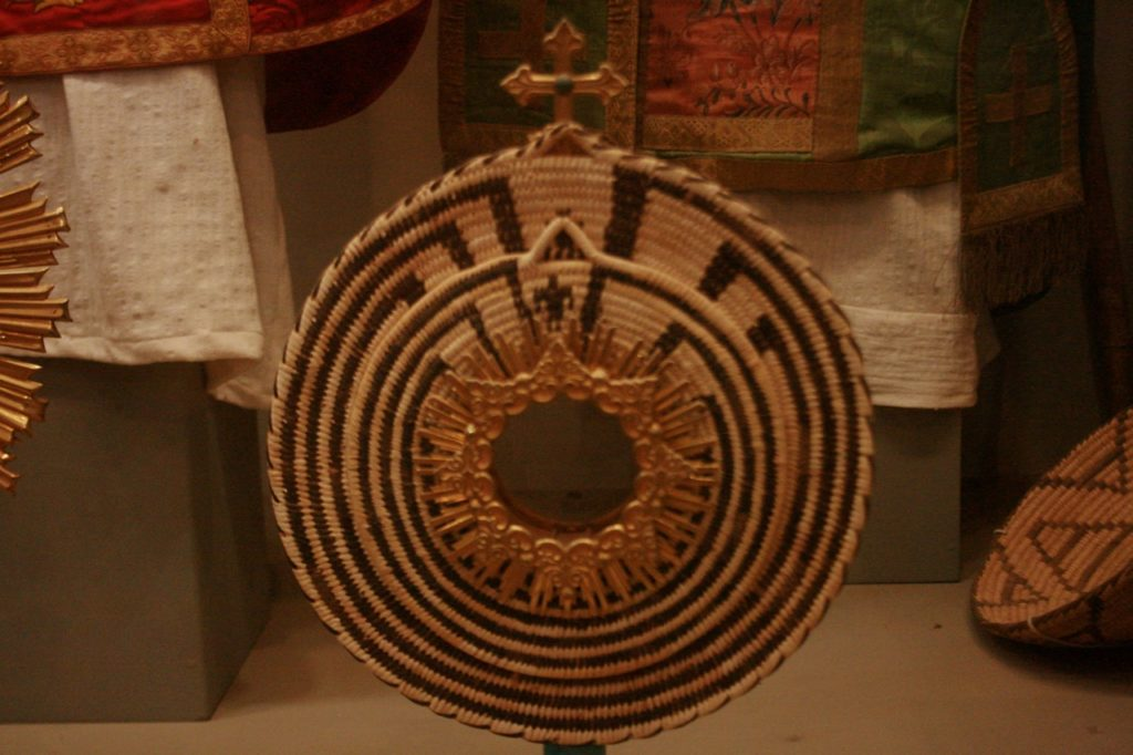 Tohono O'odham basket with Catholic solar symbol mashup at San Xavier del Bac Mission