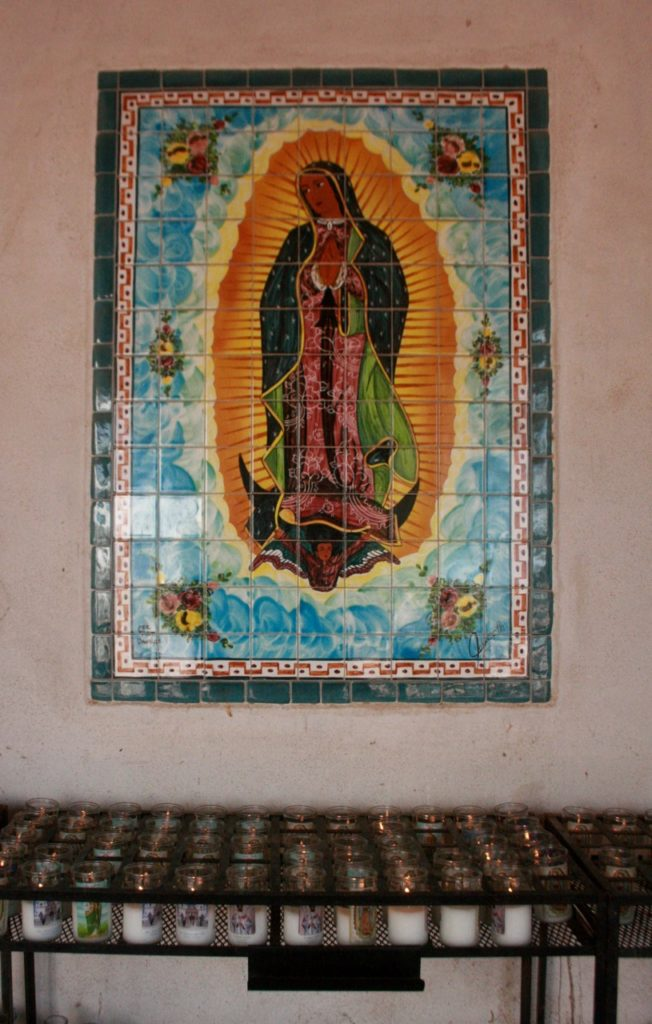 Madonna standing on a black moon tile artwork at San Xavier del Bac