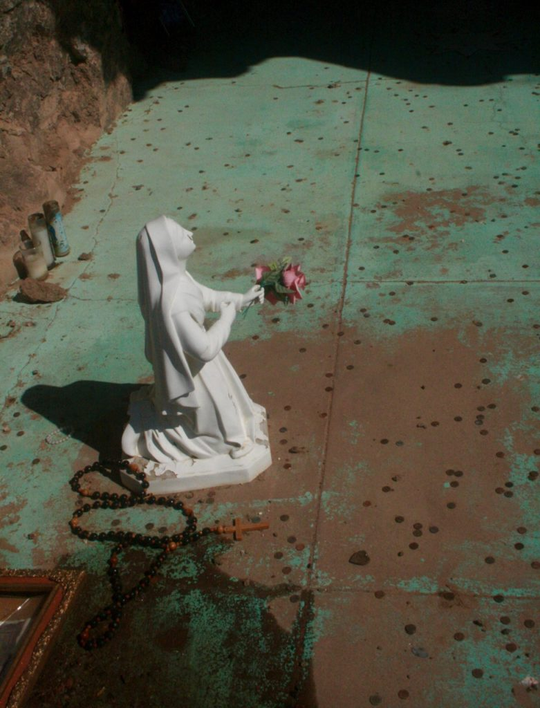 Madonna and rosary in shrine on cross mound by San Xavier mission