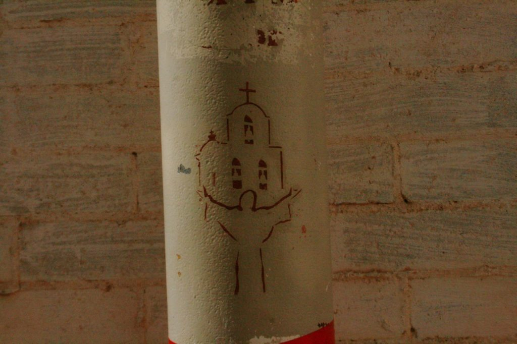 Painting on a large pipe at San Xavier